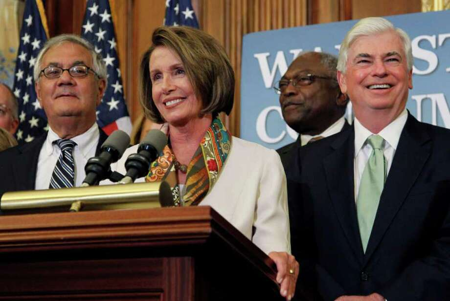 House Speaker Nancy Pelosi, D-Calif., second from left, speaks as she stands with Rep. Barney Frank, D-Mass., left, Rep. James Clyburn, D-S.C., Sen. Christopher Dodd, D-Conn., before signing the financial reform legislation bill during an enrollment ceremony on Capitol Hill in Washington Thursday, July 15, 2010.(AP Photo/Alex Brandon) Photo: Alex Brandon / AP