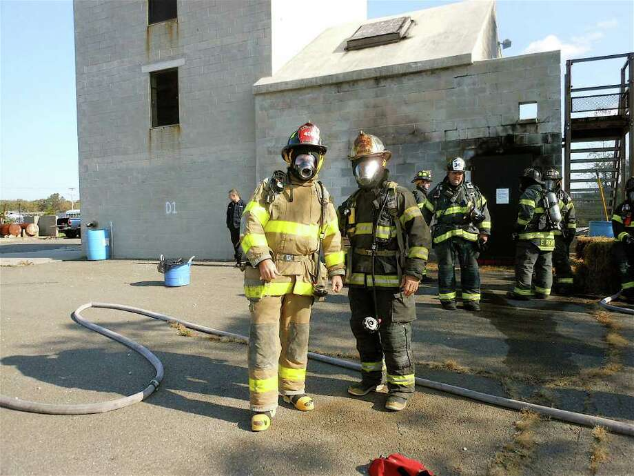 Writer Mike Lauterborn, left, and Fairfield Assistant Fire Chief Chris Tracy suited up and ready to enter attack a fire at the Fairfield Fire Training School during the recent FireOps 101 program. Photo: Mike Lauterborn / Fairfield Citizen contributed