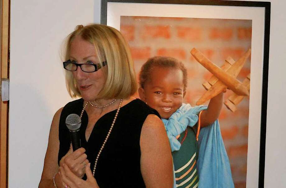 Anne Mulcahy, former Xerox CEO and Save the Children board chairwoman, addresses Westport Arts Center exhibit Friday of art work by Malawian children in Save the Children's HEART program. Photo: Mike Lauterborn / Westport News contributed
