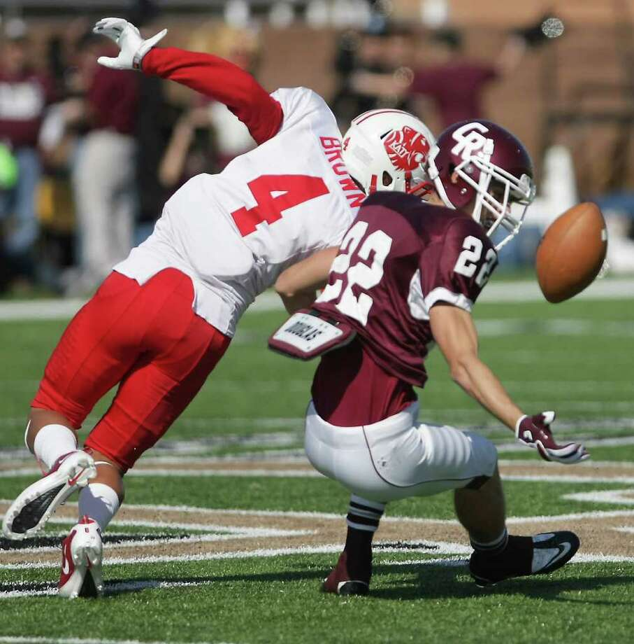 Alex Ludowig of Cinco Ranch High School (22) can't pull in a pass as Isaiah Brown defends  during the second quarter of a high school footbal game, Saturday, Nov. 5, 2011, at Rhodes Stadiumin Katy. Photo: Nick De La Torre, Houston Chronicle / © 2011  Houston Chronicle