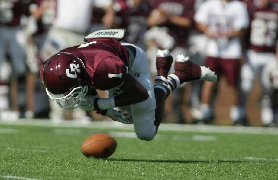 James Rhoden of Cinco Ranch High School looses fumbles the ball during the second quarter of a high school footbal game against \Katy High School, Saturday, Nov. 5, 2011, at Rhodes Stadiumin Katy. Photo: Nick De La Torre, Houston Chronicle / © 2011  Houston Chronicle