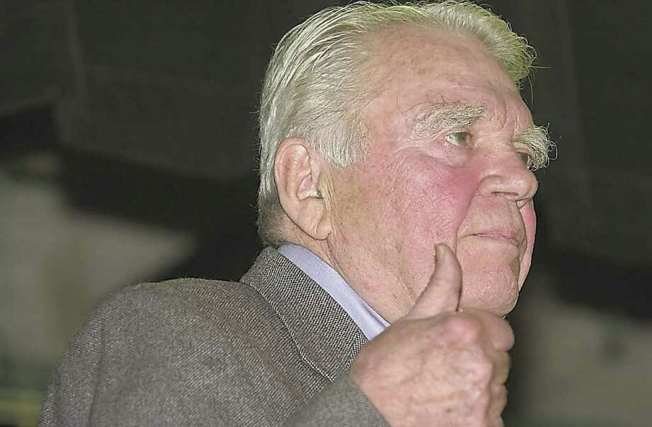Rowayton_1103_Andy Rooney gives a hand sign during his reflections on war times at Rowayton School. Photo: ST