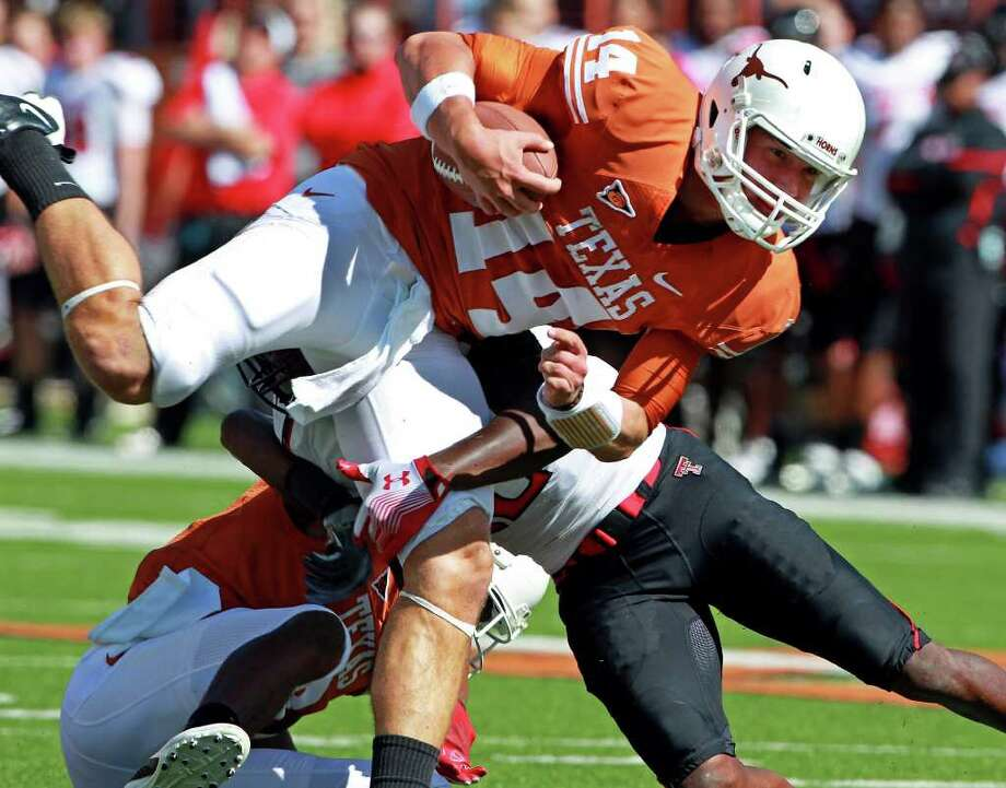 UT quarterback David Ash runs for yardage in the second quarter as Texas plays Texas Tech at Royal Stadium on November 5, 2011.  Tom Reel/Staff Photo: TOM REEL, Express-News / © 2011 San Antonio Express-News