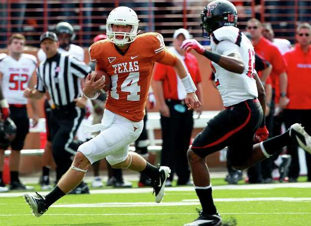 UT quarterback David Ash cuts loose for a long run in the first quarter as Texas plays Texas Tech at Royal Stadium on November 5, 2011.  Tom Reel/Staff Photo: TOM REEL, Express-News / © 2011 San Antonio Express-News