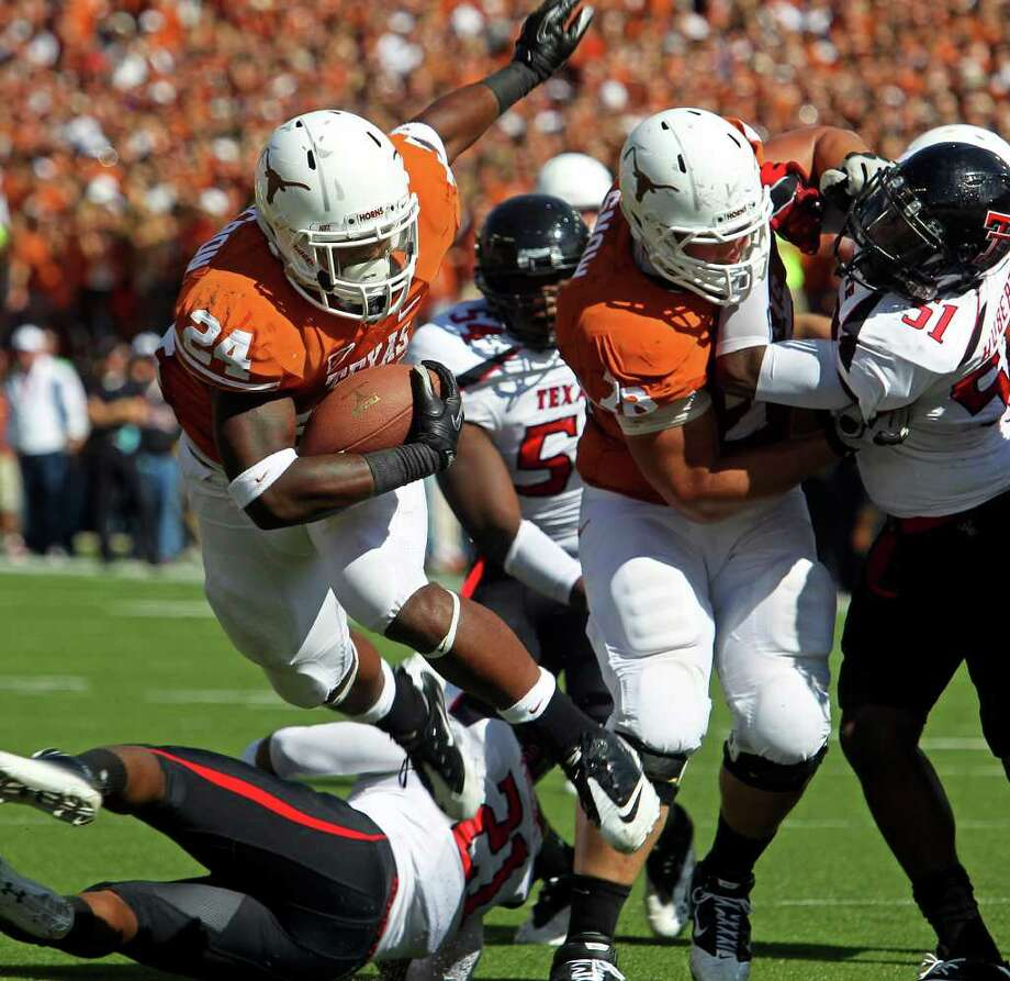 Joe Bergeron turns by a tackler and scores for the Longhorns as Texas plays Texas Tech at Royal Stadium on November 5, 2011.  Tom Reel/Staff Photo: TOM REEL, Express-News / © 2011 San Antonio Express-News
