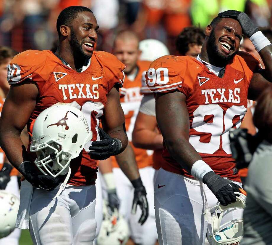 UT defensive linemen Alex Okafor (80) and Clavin Howell enjoy their walk off the field as Texas defeats Texas Tech 52-20 at Royal Stadium on November 5, 2011.  Tom Reel/Staff Photo: TOM REEL, E / © 2011 San Antonio Express-News