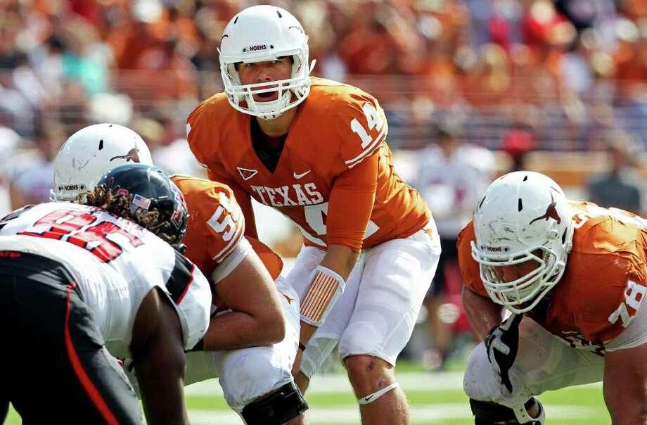 UT quarterback David Ash barks signals near the goal line in the third quarter as Texas plays Texas Tech at Royal Stadium on November 5, 2011.  Tom Reel/Staff Photo: TOM REEL, E / © 2011 San Antonio Express-News