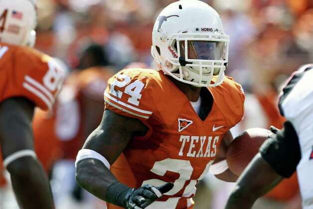 Joe Bergeron picks his way through for his final touchdown as Texas plays Texas Tech at Royal Stadium on November 5, 2011.  Tom Reel/Staff Photo: TOM REEL, E / © 2011 San Antonio Express-News