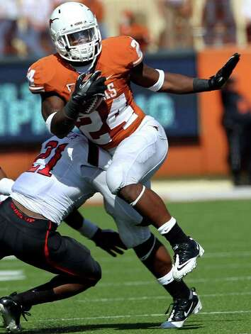 UT running back makes a cut in the open field as Texas plays Texas Tech at Royal Stadium on November 5, 2011.  Tom Reel/Staff Photo: TOM REEL, E / © 2011 San Antonio Express-News