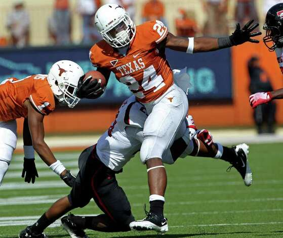 UT running back Joe Bergeron rambles for more yardage in the third quarter as Texas plays Texas Tech at Royal Stadium on November 5, 2011.  Tom Reel/Staff Photo: TOM REEL, E / © 2011 San Antonio Express-News