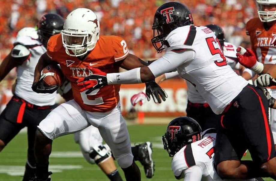 Fozzy Whittaker scores for the Horns as Texas plays Texas Tech at Royal Stadium on November 5, 2011.  Tom Reel/Staff Photo: TOM REEL, E / © 2011 San Antonio Express-News