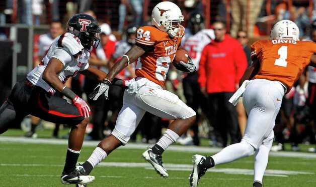 UT receiver Marquise Goodwin takes the ball under to the left as Texas plays Texas Tech at Royal Stadium on November 5, 2011.  Tom Reel/Staff Photo: TOM REEL, E / © 2011 San Antonio Express-News