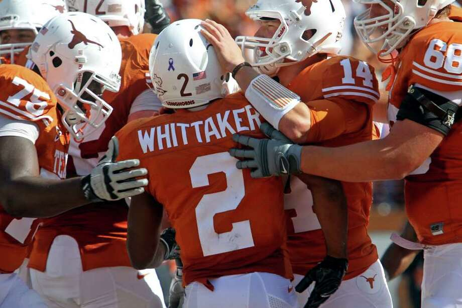 UT teammates congratulate Fozzy Whittaker in the first half as Texas plays Texas Tech at Royal Stadium on November 5, 2011.  Tom Reel/Staff Photo: TOM REEL, Express-News / © 2011 San Antonio Express-News