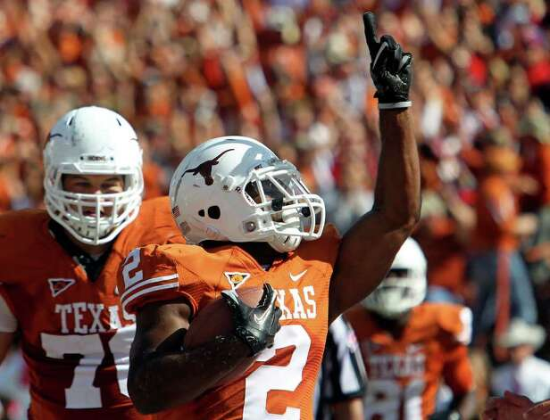 Fozzy Whittaker celebrates his touchdown run in the first half as Texas plays Texas Tech at Royal Stadium on November 5, 2011.  Tom Reel/Staff Photo: TOM REEL, Express-News / © 2011 San Antonio Express-News