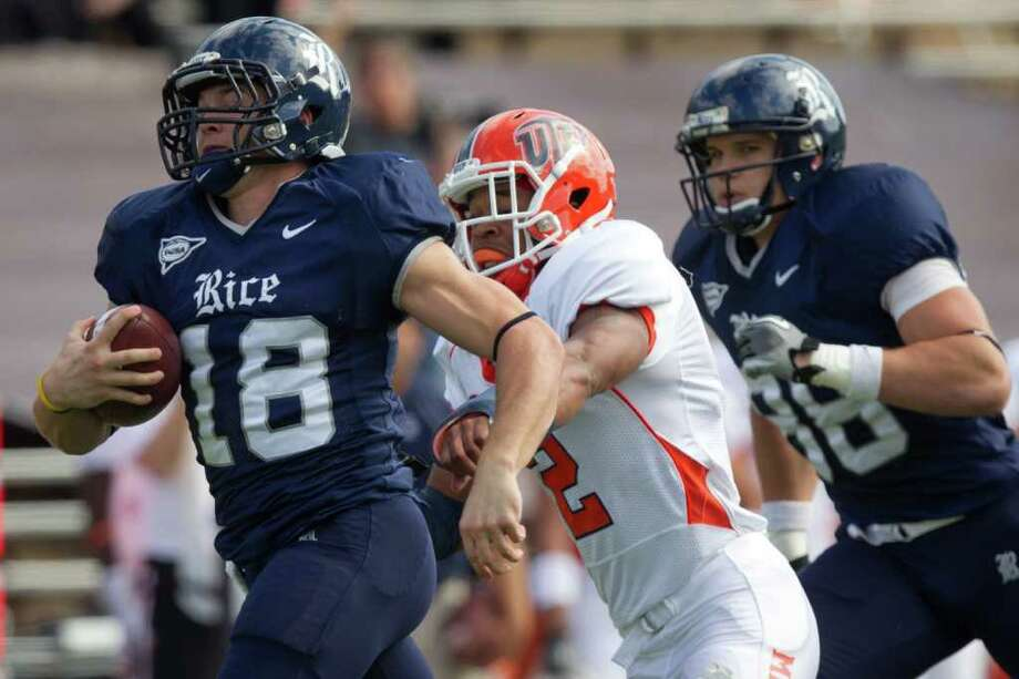 Rice Owls running back Turner Petersen (18) gets past UTEP Miners defensive back DeShawn Grayson (2) on a 44-yard touchdown run during the first half of an NCAA football game at Rice Stadium, Saturday, Nov. 5, 2011, in Houston. Photo: Smiley N. Pool, Houston Chronicle / © 2011  Houston Chronicle