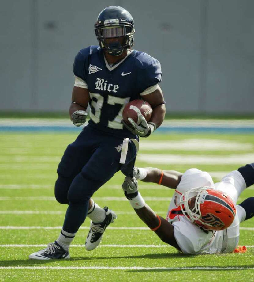 Rice Owls running back Tyler Smith (37) is brought down by UTEP Miners defensive back Travaun Nixon (5) during the first half of an NCAA football game at Rice Stadium, Saturday, Nov. 5, 2011, in Houston. Photo: Smiley N. Pool, Houston Chronicle / © 2011  Houston Chronicle