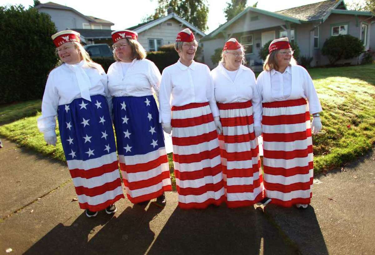 From left, Patti Kerrigan, Janeil Post, Diane Sifres, Judy Skaggs and Maggie Hulse of the White Center Fraternal Order of Eagles wait for their turn to march during the regional Auburn Veterans Day Parade on Saturday, November 5, 2011 in downtown Auburn. The parade, billed as the largest Veterans Day parade west of the Mississippi, has been held in the King County town for 46 years.