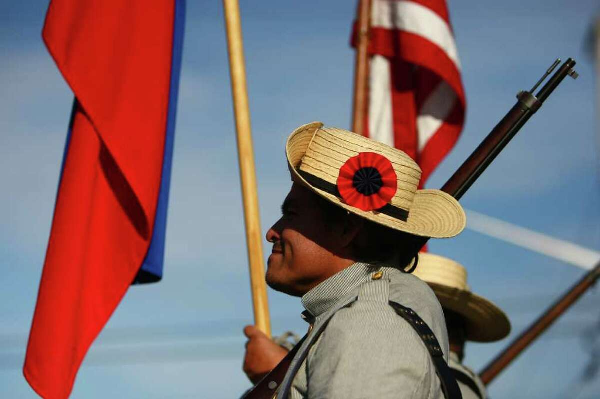A Spanish-American War entry marches during the regional Auburn Veterans Day Parade on Saturday in downtown Auburn. The parade, billed as the largest Veterans Day parade west of the Mississippi, has been held in the King County town for 46 years.