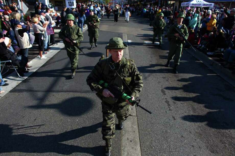 Participants in Vietnam War-era uniforms march during the regional Auburn Veterans Day Parade. Photo: JOSHUA TRUJILLO / SEATTLEPI.COM