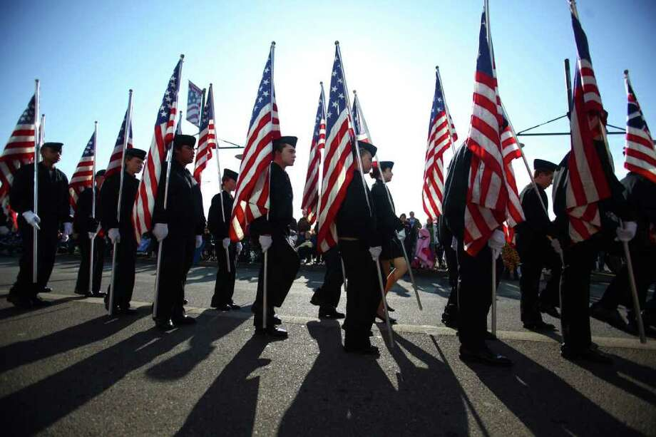 Junior ROTC students march with flags during the regional Auburn Veterans Day Parade. Photo: JOSHUA TRUJILLO / SEATTLEPI.COM