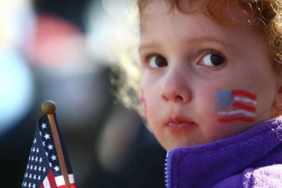 A young spectator watches the dozens of marching bands and historic vehicles during the regional Auburn Veterans Day Parade. Photo: JOSHUA TRUJILLO / SEATTLEPI.COM