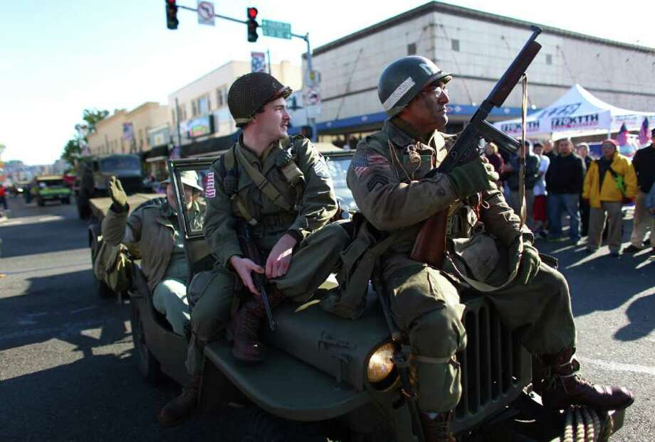 Parade participants in World War II-era uniforms participate during the regional Auburn Veterans Day Parade. Photo: JOSHUA TRUJILLO / SEATTLEPI.COM