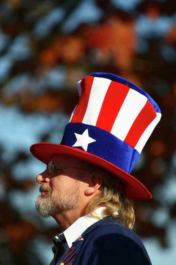 A participant dressed as Uncle Sam marches along the route. Photo: JOSHUA TRUJILLO / SEATTLEPI.COM