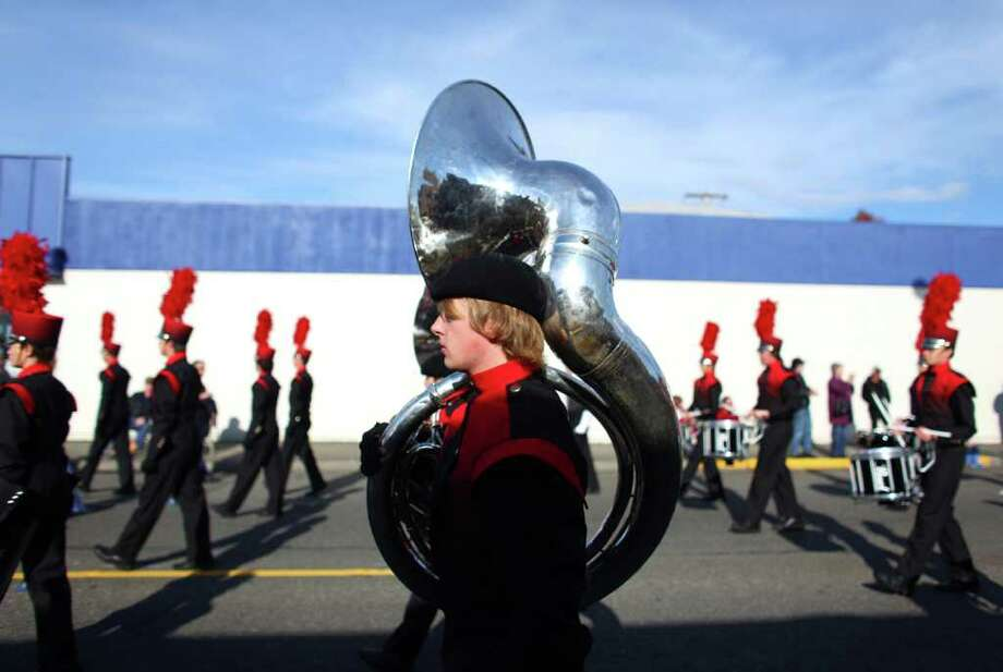 The Cascade High School marching band makes its way along the route during the regional Auburn Veterans Day Parade. Photo: JOSHUA TRUJILLO / SEATTLEPI.COM