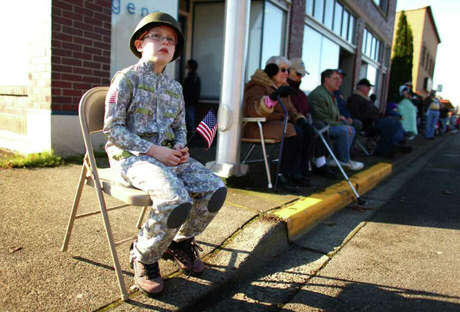 Colby Shropshire, 9, shows his support during the regional Auburn Veterans Day Parade. Photo: JOSHUA TRUJILLO / SEATTLEPI.COM