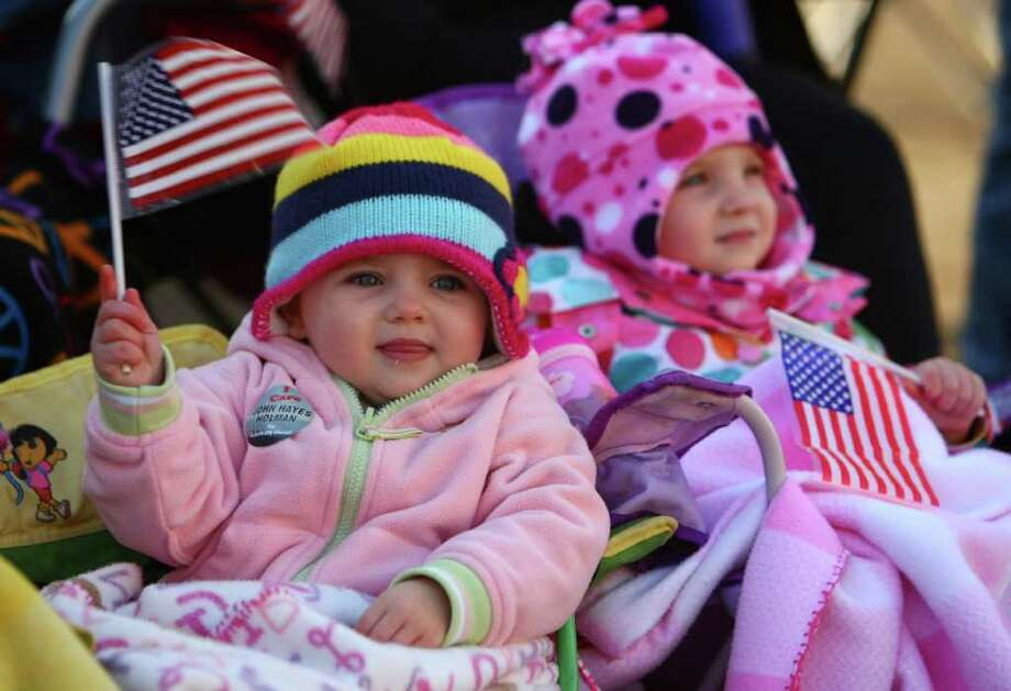 Twin sisters Bailey Mills, 2, and Abbey Mills, of Puyallup, wave flags. Photo: JOSHUA TRUJILLO / SEATTLEPI.COM