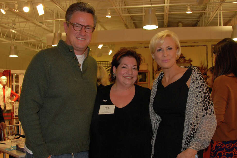 MSNBC Morning Joe co-hosts Joe Scarborough and Mika Brzezinski pose with Patricia Russo, center, president of the Women's Campaign School at Yale, at the Ladies Who Launch benefit at J. McLaughlin in Westport last month. The event raised funds for the center, which supports women running for political office. Photo: Contributed Photo