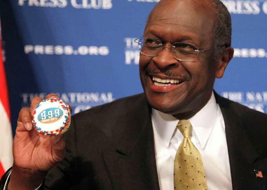 In this Oct. 31, 2011, photo, Republican presidential candidate Herman Cain holds up a muffin that has his catch-phrase 9-9-9 tax plan printed on it, before speaking at the National Press Club in Washington. Cain has made humor a central to his candidacy for the Republican presidential nomination. When his jokes raise eyebrows, he says he didn?t mean to offend. As he fights allegations he sexually harassed two women, Cain is gambling the same line of defense will help defuse his campaign?s biggest crisis. (AP Photo/Pablo Martinez Monsivais) Photo: Pablo Martinez Monsivais / AP