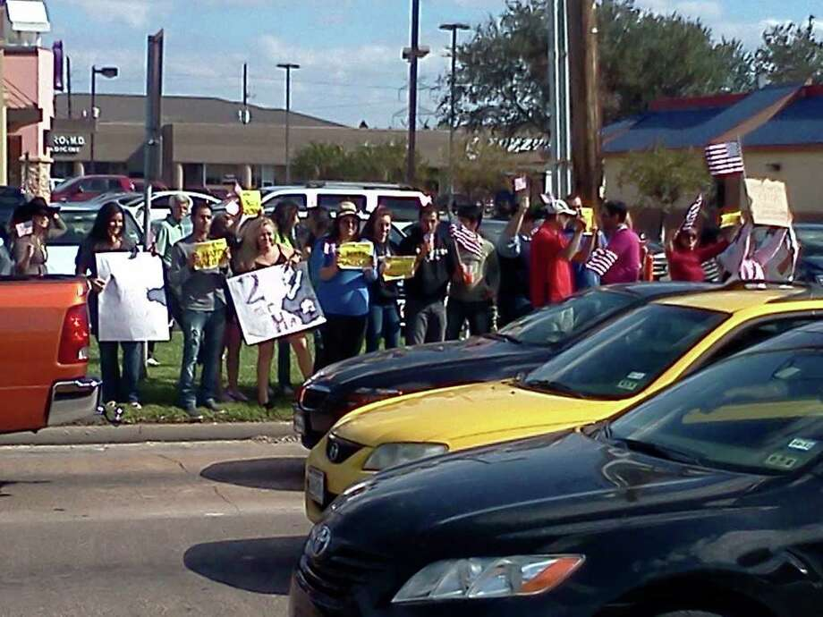 People protest against Nonmacher's Bar-B-Que, 606 S. Mason Rd. Photo: Louis Casiano / © 2011 Houston Chronicle