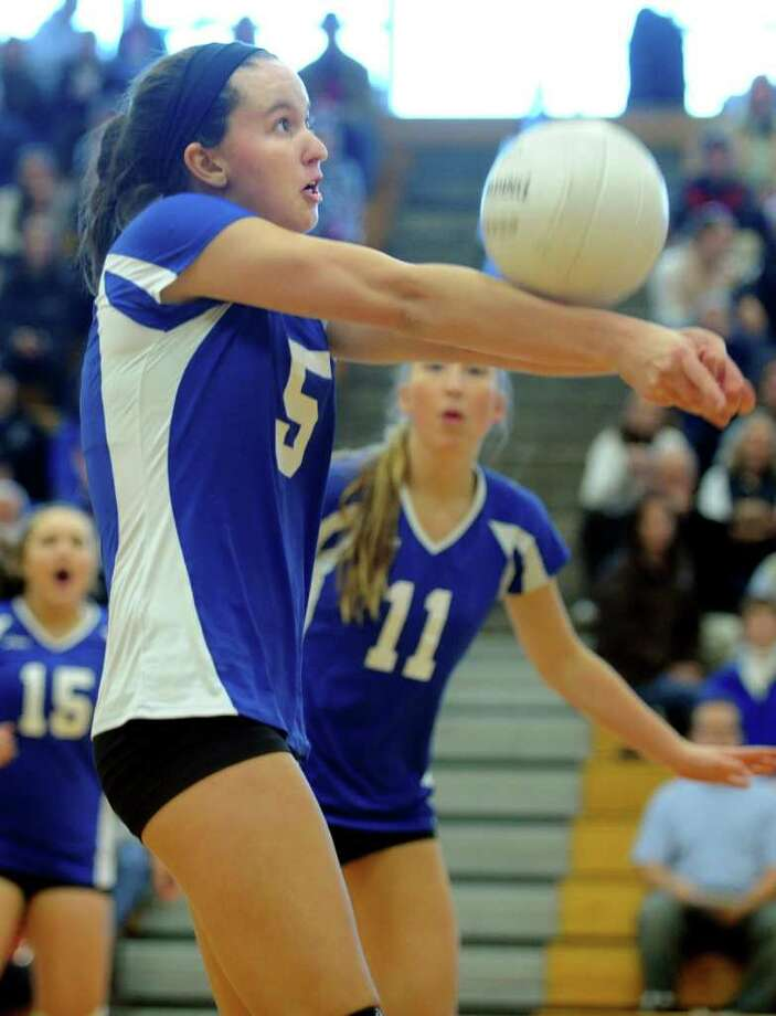Darien's Riley Sousa returns the ball to Ridgfield during the FCIAC Girls' Volleyball Championship Saturday, Nov. 5, 2011 on the campus of Fairfield Ludlowe High School in Fairfield, Conn. Photo: Autumn Driscoll / Connecticut Post