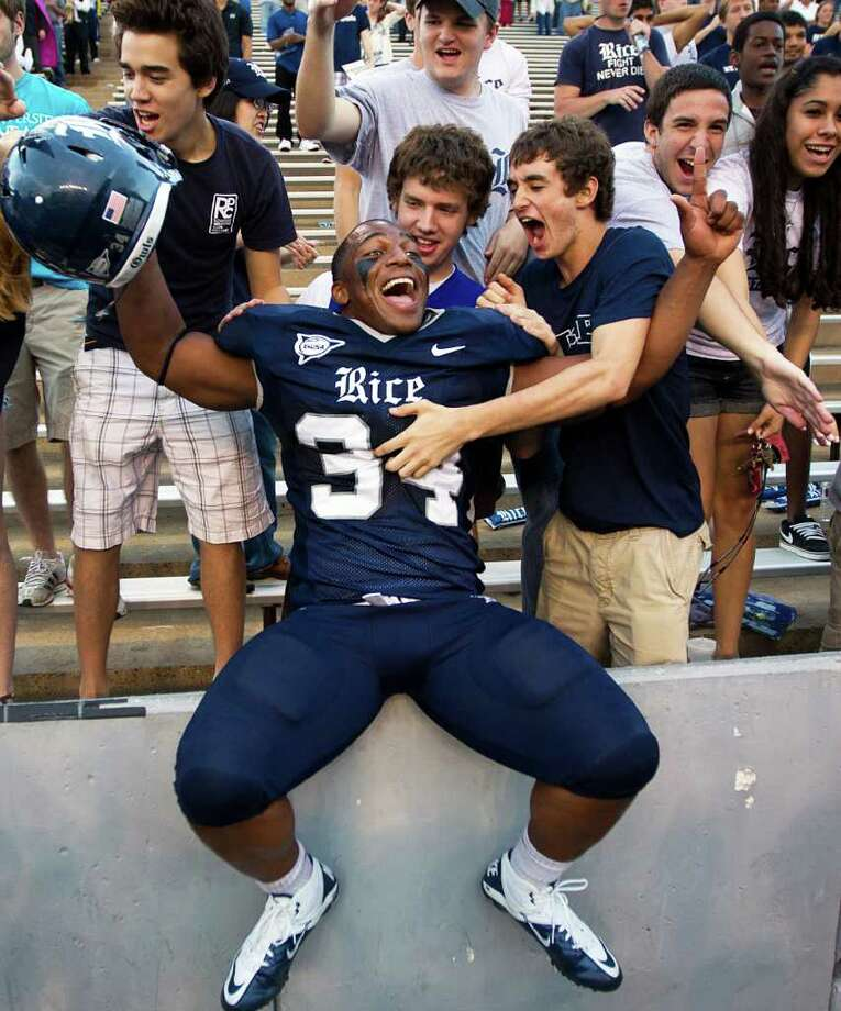 Rice linebacker Cameron Nwosu, shown here celebrating a win last season, had a big game on Thursday night. Photo: Smiley N. Pool, Associated Press / © 2011  Houston Chronicle
