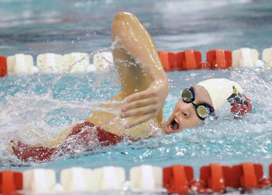 Greenwich High School swimmer Morgan Karetnick swims the free-style  leg of the 200 IM during the FCIAC girls swimming championships at Greenwich High School, Saturday afternoon, Nov. 5, 2011. Photo: Bob Luckey / Greenwich Time