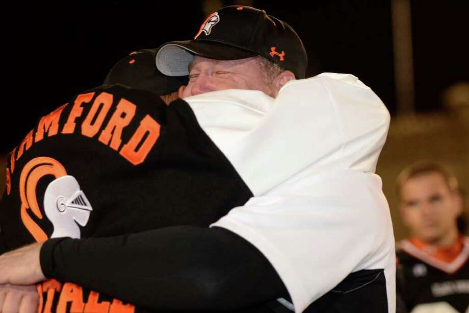 Coach Bryan Hocter  of Stamford High School celebrates the win over New Canaan High School 36 - 29 in varsity football in Stamford, CT on Sat., Nov. 5, 2011. Photo: Shelley Cryan / Shelley Cryan freelance; Stamford Advocate freelance