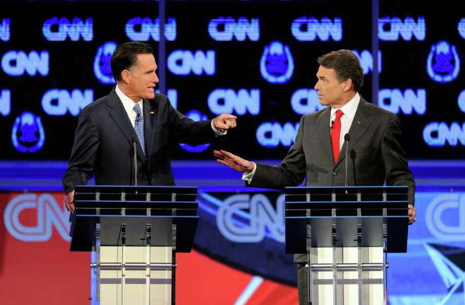 Ethan Miller: Getty Images RIVALS: Former Massachusetts Gov. Mitt Romney, left, and Texas Gov. Rick Perry debate late month in Las Vegas. Photo: Ethan Miller / 2011 Getty Images