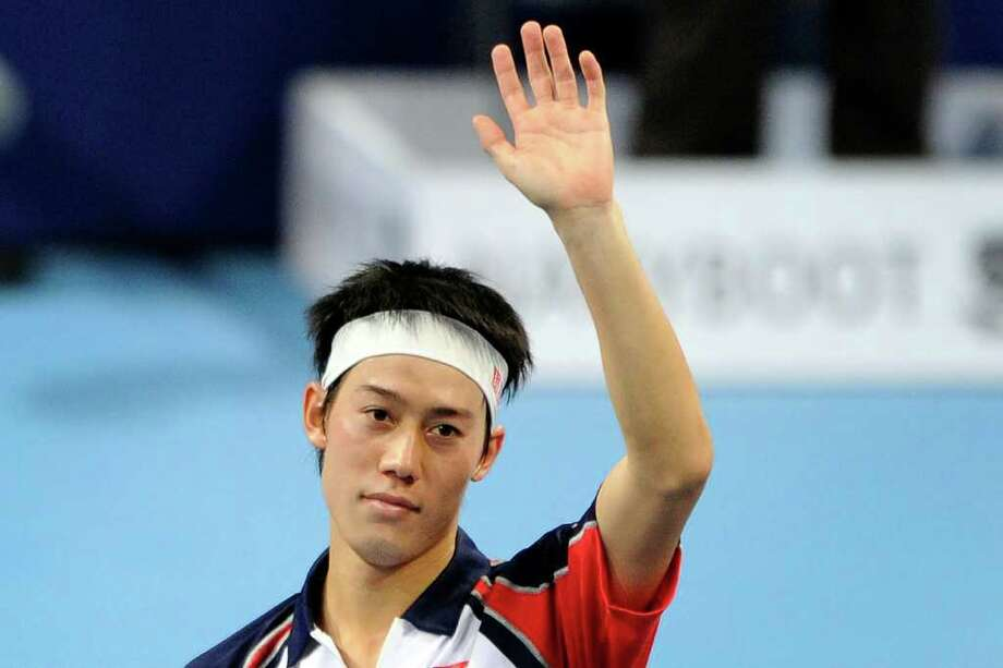 Japan's Kei Nishikori celebrates after winning his semi-final match against Serbia's Novak Djokovic at the Swiss Indoors ATP tennis tournament match on November 5, 2011 in Basel. Nishikori won 2-6, 7-6 (7/4), 6-0.    AFP PHOTO / FABRICE COFFRINI (Photo credit should read FABRICE COFFRINI/AFP/Getty Images) Photo: FABRICE COFFRINI / AFP