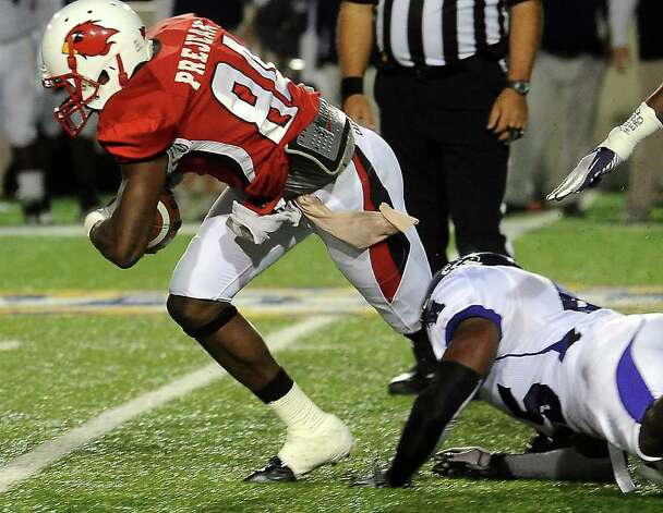 Lamar's Kendrick Prejean breaks free from a tackle by SFA's Derrick Choice at the Provost Umphrey Stadium at Lamar University in Beaumont, Saturday, November 5, 2011. Tammy McKinley/The Enterprise Photo: TAMMY MCKINLEY