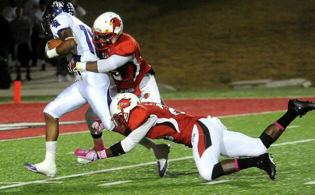 Lamar's Michael Allen II and Chad Allen attempt to stop SFA's Gralyn Crawford at the Provost Umphrey Stadium at Lamar University in Beaumont, Saturday, November 5, 2011. Tammy McKinley/The Enterprise Photo: TAMMY MCKINLEY