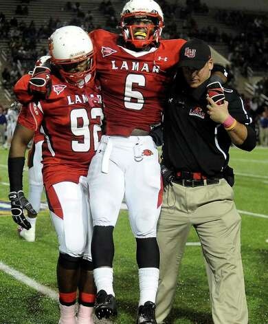 Lamar's Jordan Garrett is carried off the field with an injury during the game against Stephen F. Austin at the Provost Umphrey Stadium at Lamar University in Beaumont, Saturday, November 5, 2011. Tammy McKinley/The Enterprise Photo: TAMMY MCKINLEY