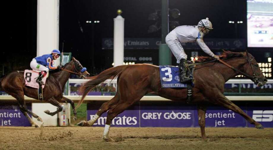 MORRY GASH: ASSOCIATED PRESS CLASSIC FINISH: Chantal Sutherland, aboard Game On Dude (8), watches as Mike Smith takes Drosselmeyer (3) across the finish line Saturday to win the $5 million Breeders' Cup Classic at Churchill Downs in Louisville, Ky. Photo: Morry Gash / AP
