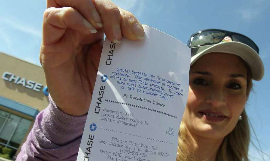 MoveOn.org of San Antonio's Jennifer Stephenson shows a part of her receipt that she withdrew $99 in protest from Chase Bank. Her group and Occupy San Antonio joined near two banks on Vance Jackson to decry the banks' alleged greed. Photo: Kin Man Hui, Kin Man Hui/kmhui@express-news.net / San Antonio Express-News