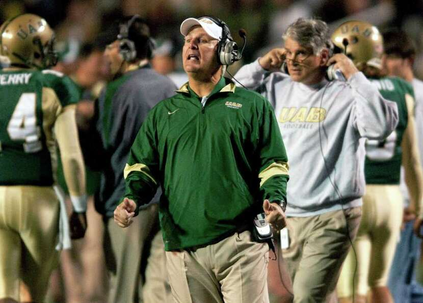 UAB coach Neil Callaway looks on in the first half of an NCAA college football game against Houston,