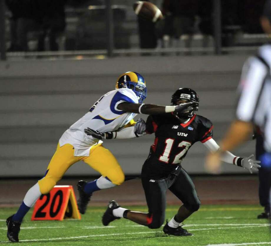 Incarnate Word receiver Stan Sullivan is unable to catch a pass as Travis McCloud, left, defends during college football action at Benson Stadium on Saturday, Nov. 5, 2011. BILLY CALZADA / gcalzada@express-news.net