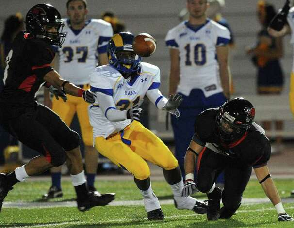 Incarnate Word punt returner Trent Rios, right, loses the ball as Jared Ross of Angelo State chases it during first-half college football action at Benson Stadium on Saturday, Nov. 5, 2011. Angelo State recovered the fumble. BILLY CALZADA / gcalzada@express-news.net  Angelo State at Incarnate Word Photo: BILLY CALZADA, Express-News / gcalzada@express-news.net