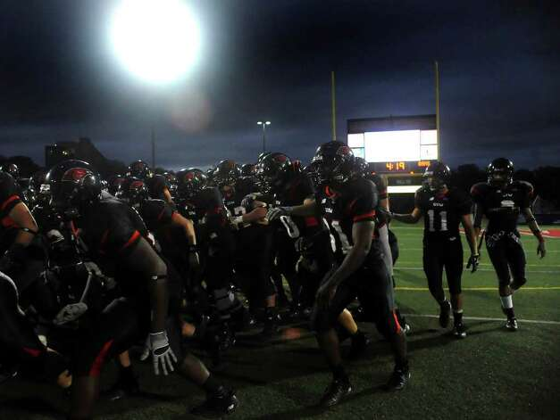 The Incarnate Word Cardinals take the field for their game against Angelo State at Benson Stadium on Saturday, Nov. 5, 2011. BILLY CALZADA / gcalzada@express-news.net  Angelo State at Incarnate Word Photo: BILLY CALZADA, Express-News / gcalzada@express-news.net