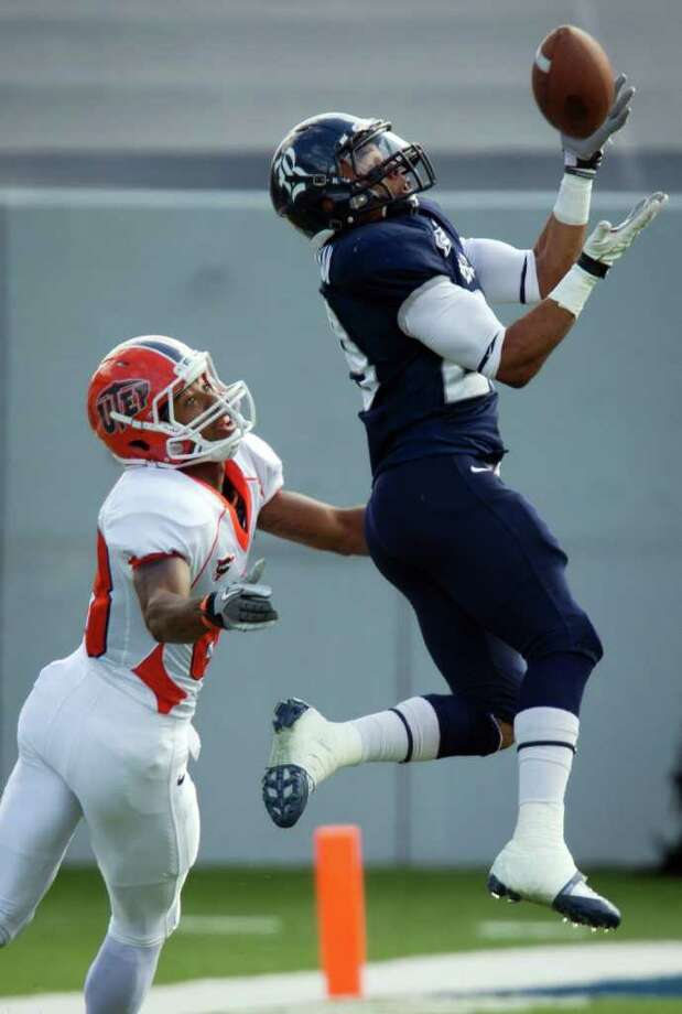 SMILEY N. POOL: CHRONICLE DRIVE STOPPER: Rice cornerback Bryce Callahan intercepts a pass intended for UTEP's Lavorick Williams during the first half Saturday. Photo: Smiley N. Pool / © 2011  Houston Chronicle