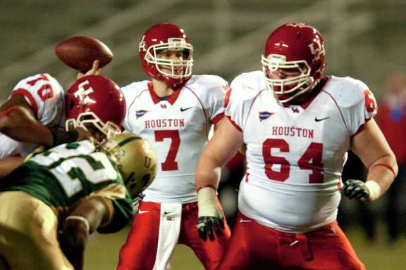 Houston's Case Keenum passes in the second  half of their NCAA college football game against UAB in Birmingham, Ala., Saturday, Nov. 5, 2011. Keenum threw for 407 yards to become the most prolific passer in NCAA history and he added his first two rushing touchdowns of the season to lead Houston past UAB 56-13. (AP Photo/Bob Farley)